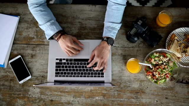 top view of man using laptop at work - photography themes stock videos & royalty-free footage