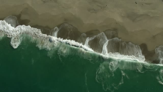 top view of ocean waves pounding on point reyes beach - tracking shot stock videos & royalty-free footage