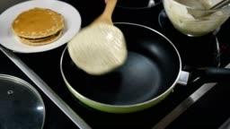 Top view of pancake flipped on frying pan