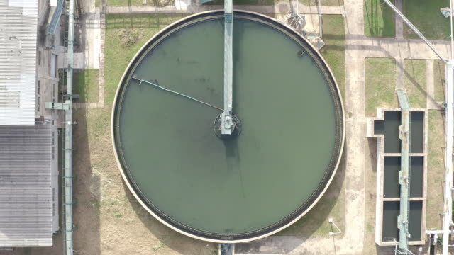 top view of recirculation solid contact clarifier sedimentation tank. industrial water treatment in factory. - purity stock videos & royalty-free footage