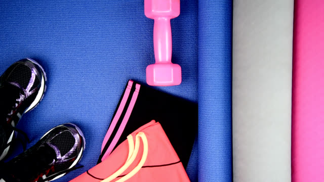 Top view of sport equipment with yoga mat / healthy conceptual