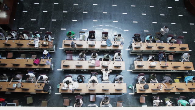ews top view of student using computer in beijing university library / beijing, china - university stock videos and b-roll footage