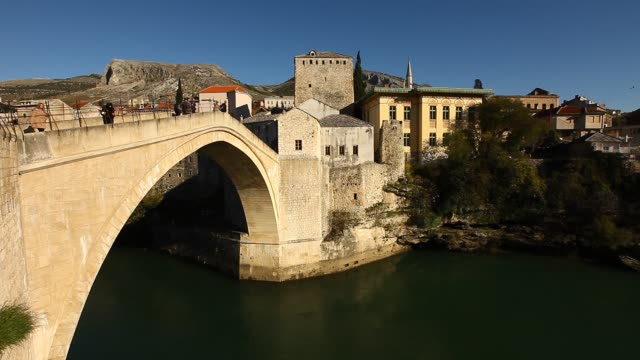 top view of the mostar old bridge - religious symbol stock videos & royalty-free footage