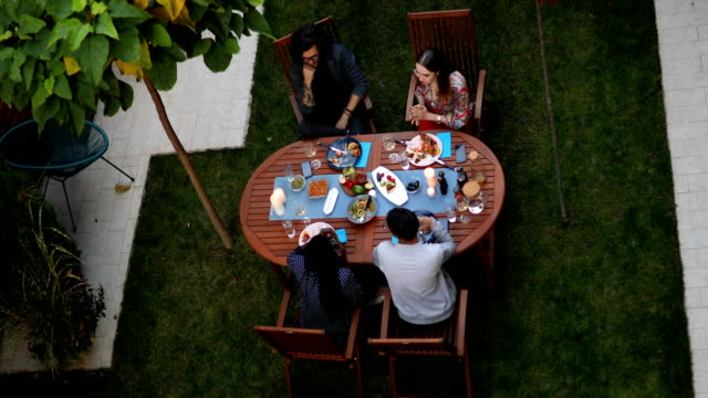 top view of young people having dinner outdoors - meal stock videos & royalty-free footage