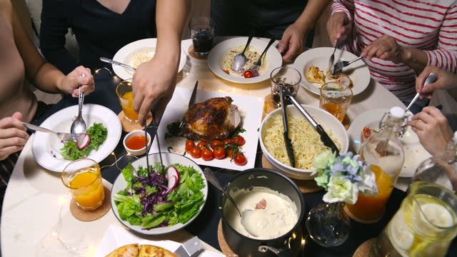 top view on the table, family together dinner in the evening of the celebration in the house. - table top view stock videos & royalty-free footage
