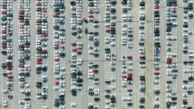 t/l top view over outdoor parking lots - parking stock videos & royalty-free footage