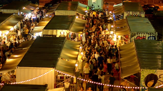 top view : people walk in night market in container