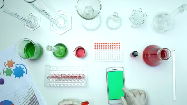 top view scientist using smart phone in laboratory - replication bubble stock videos and b-roll footage