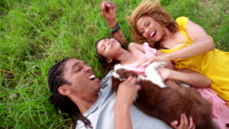 Top view shot of African-American family lying on their backs