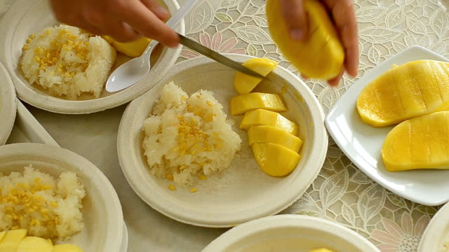 top view : sliced mango and sticky rice is on paper plate for meeting - paper plate stock videos & royalty-free footage