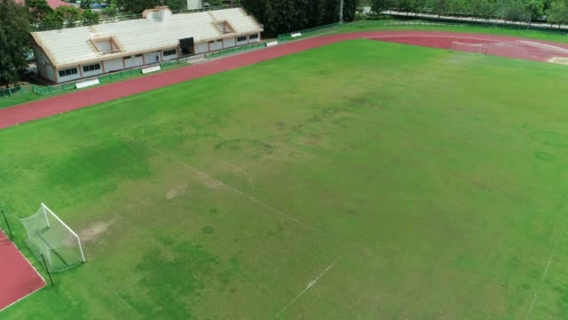 top view, stadium football 4k resolution aerial shot by drone - football pitch stock videos & royalty-free footage