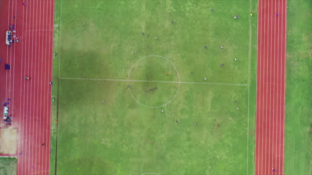 top view, stadium football 4k resolution aerial shot by drone - pitch stock videos & royalty-free footage