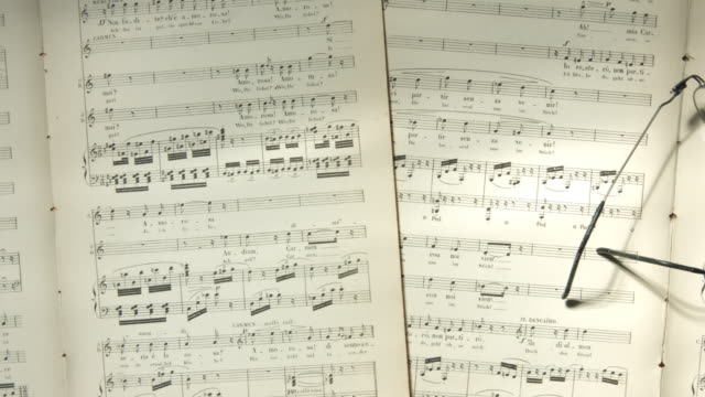 top view tracking shot over musical notes - sheet music stock videos & royalty-free footage