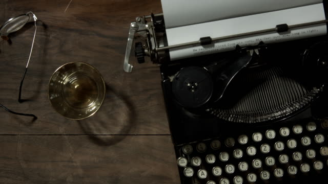 top view tracking shot over old typewriter on a desk - table top shot video stock e b–roll