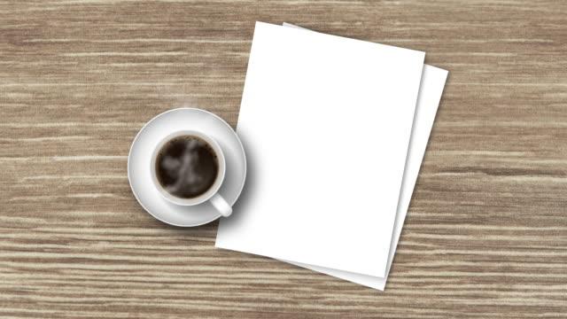 top-view holztisch mit heißem schwarzen kaffee und weißem papier - table top view stock-videos und b-roll-filmmaterial