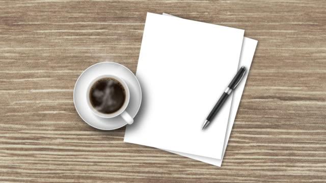 top-view holztisch mit heißem schwarzen kaffee, weißen papieren und einem stift - table top view stock-videos und b-roll-filmmaterial
