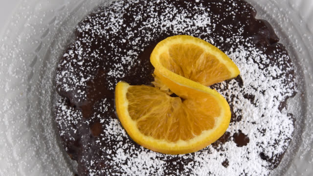top-down view of a chocolate and orange gluten-free cake - gluten free stock videos & royalty-free footage