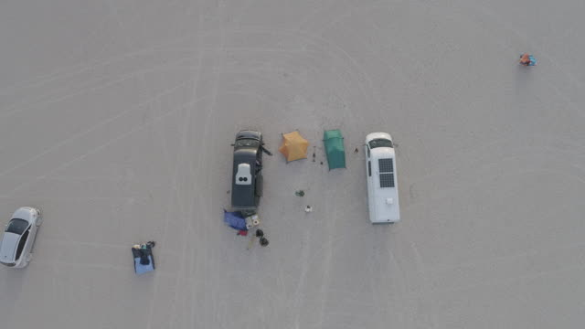 aerial: top-down view of a group car camping in the alvord desert - top video stock e b–roll