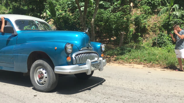 topes de collantes, cienfuegos, cuba-september 9, 2019: a vintage old american car drives in the escambray mountains specifically in the road leading... - eco tourism stock videos & royalty-free footage