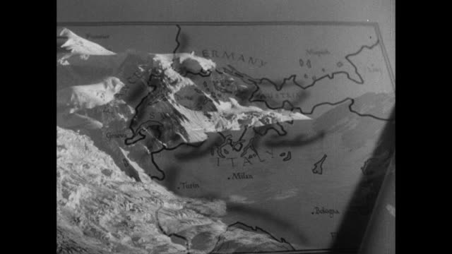 montage topographical map, and snow-covered alpine mountains / switzerland - switzerland video stock e b–roll