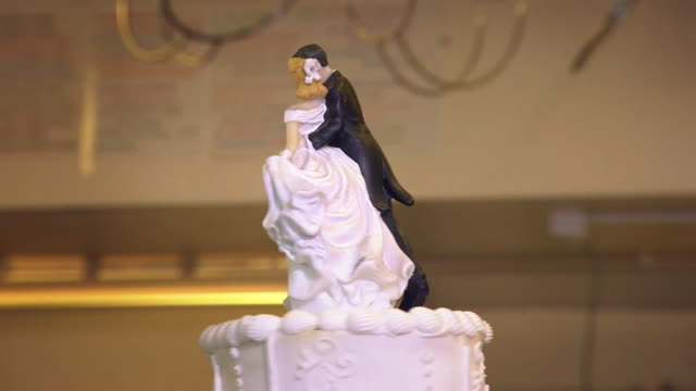 toppers being fitted onto a wedding cake - female likeness stock videos & royalty-free footage