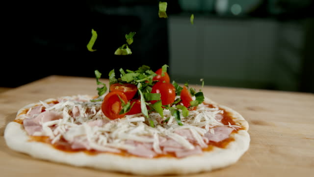 slo mo topping the pizza with fresh tomato and spices - sprinkling stock videos and b-roll footage