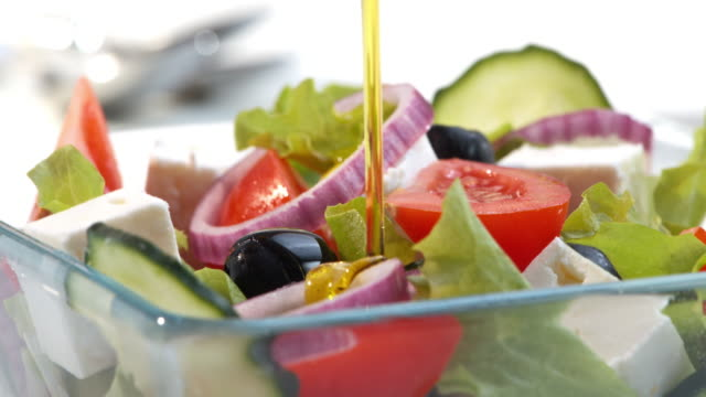 Topping the salad with olive oil