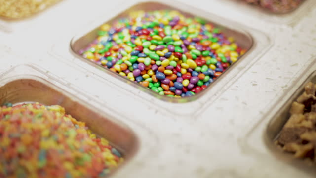 toppings for ice cream or frozen yogurt - sprinkles stock videos & royalty-free footage
