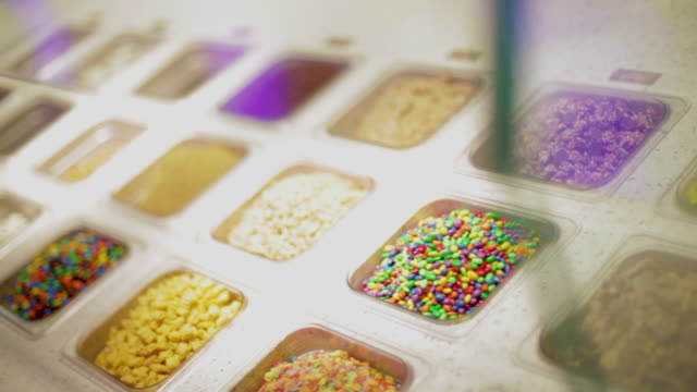 toppings for ice cream or frozen yogurt - frozen yogurt stock videos and b-roll footage