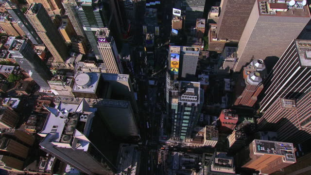 AERIAL Tops of skyscrapers and buildings, with city streets between and the edge of Central Park / New York City, New York, United States