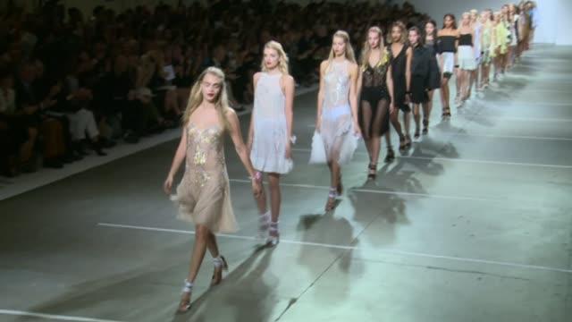 topshop defend using super skinny mannequins; lib london: int models along catwalk at topshop fashion show - ほっそりした点の映像素材/bロール