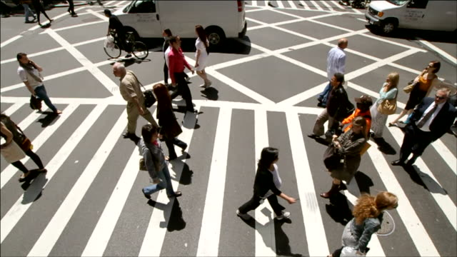 topshot on a crosswalk in manhattan with pedestrians - pedestrian crossing stock videos and b-roll footage