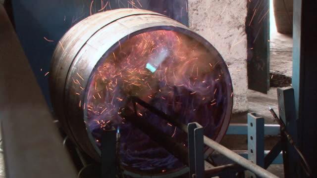 vídeos de stock, filmes e b-roll de ha torch burning the inside of a whiskey cast / highlands, scotland, united - barril