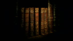 Torch Lights Up Old Books On Shelf