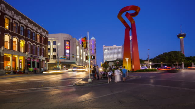 torch of friendship sculpture and traffic in downtown san antonio, texas - time lapse - san antonio texas stock videos and b-roll footage