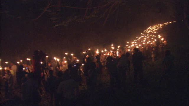 torch procession snakes through forest - flaming torch stock videos & royalty-free footage