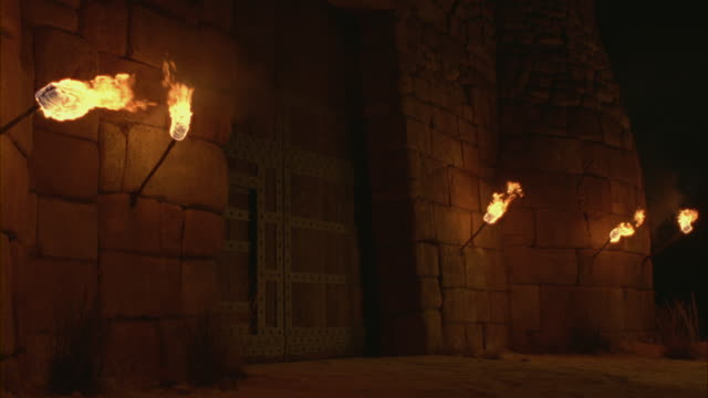 torches flickering on the walls of a castle. - flaming torch stock videos & royalty-free footage