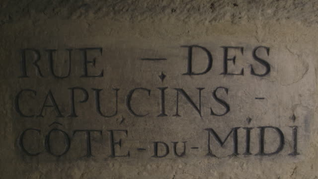 torchlight reveals an underground street sign reading 'rue des capucins cotedumidi' paris france fkax912p clip taken from programme rushes abma938f - claustrophobia stock videos & royalty-free footage