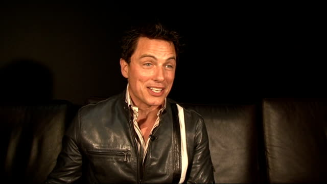 cast interviews; barrowman interview sot - don't think you will ever see dr who crossover with torchwood - would love to do musical torchwood but... - fade in video transition stock videos & royalty-free footage