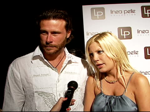 tori spelling and dean mcdermott on being newlyweds and happy everywhere they go, on being happier than ever, on the best jeans, beauty product you... - tori spelling stock videos & royalty-free footage