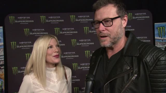 vídeos de stock e filmes b-roll de interview tori spelling and dean mcdermott on his love for motorcycles why she puts up with it and being at tonight's event at monster energy... - tori spelling