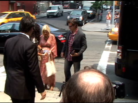 tori spelling and dean mcdermott pause to sign autographs as the arrive at digitas 2011 at the skyline in new york 06/09/11 - autographing stock videos and b-roll footage