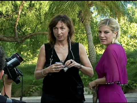 tori spelling at the bow wow ciao benefit for 'much love' animal rescue at john paul & eloise dejoria estate in malibu, california on august 5, 2006. - tori spelling stock videos & royalty-free footage