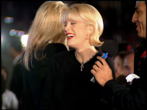 tori spelling at the 'interview with the vampire' premiere at the mann village theatre in westwood california on november 9 1994 - レジェンシービレッジシアター点の映像素材/bロール