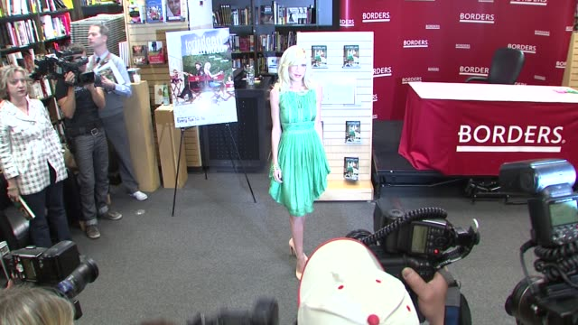 tori spelling at the tori spelling signs copies of 'mommywood' - april 17, 2009 at new york ny. - tori spelling stock videos & royalty-free footage