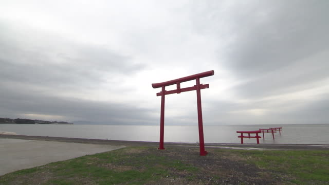 """""""torii"""" is the entrance gate commonly found at shinto shrine where it symbolically marks the transition from the profane to sacred the unique thing... - shinto shrine stock videos & royalty-free footage"""