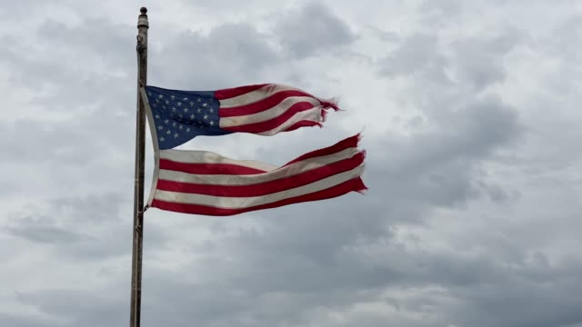 torn american flag - tilt up - american culture stock-videos und b-roll-filmmaterial
