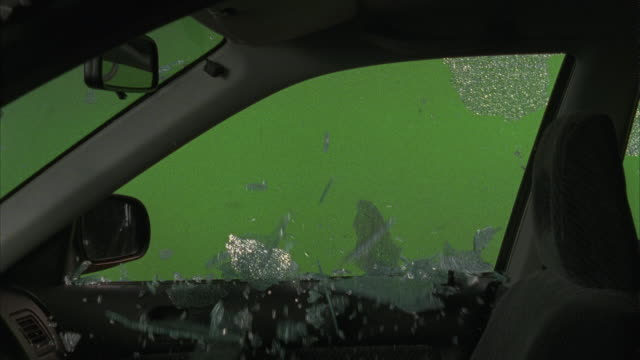 a tornado causes the window of a car to break. - chroma key stock videos & royalty-free footage