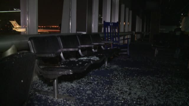 Tornado damage closes concourse at Lambert International Airport/ Storm shatters windows tears off roof and sends water pouring into concourse/...
