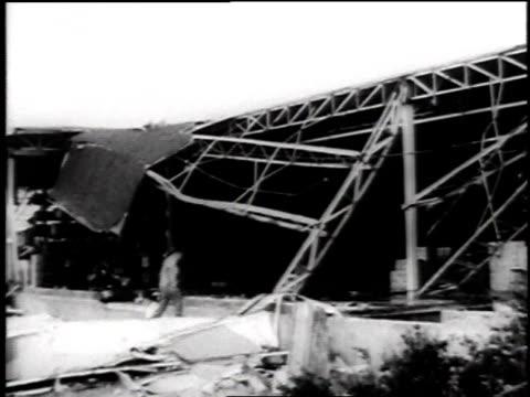vídeos de stock e filmes b-roll de tornado damage to buildings / building collapsed / damage to a bridge / train fallen off the track / overturned vehicle - 1957